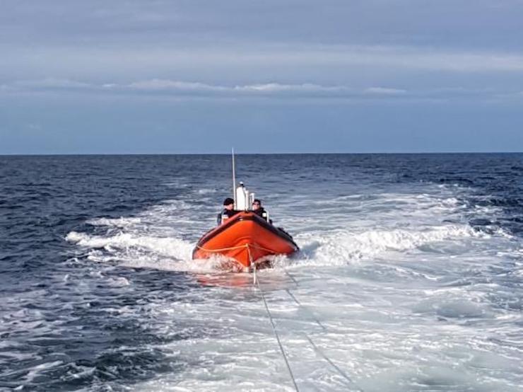 Dive boat Argo under tow.